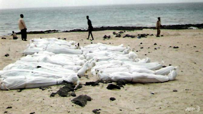 a-photo-taken-in-march-2006-and-obtained-from-the-united-nations-high-commissioner-for-refugees-unhcr-shows-the-bodies-of-young-men-believed-to-be-somali-refugees-found-on-yemen-s-red-sea-coastline-in-1502379906689-.jpg